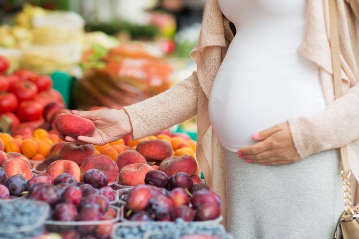 Pregnant Women Picking Fruit